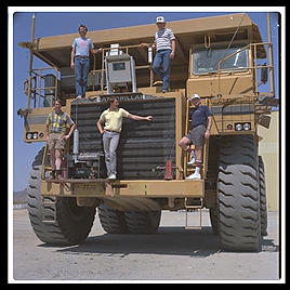 Just your average $750,000 1200-horsepower mining truck, at Caterpillar's Arizona Proving Grounds in Goodyear (east of Phoenix).  I wrote some Lisp software to coordinate earthmoving operations and CAT was testing it.  That's me in the blue Consolve T-shirt on the right