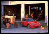 Porsche and tractor.  Amish country.  Pennsylvania.