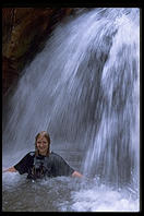 Eve Andersson in waterfall.  Grand Canyon National Park.