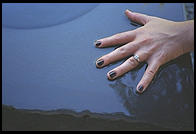 Chere's hand in a fountain at the Isamu Noguchi Garden Museum, Long Island City, Queens, New York