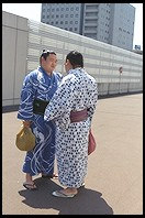Sumo wrestlers on the sidewalk.  Outside the Sumo arena.  Ryogoku District.  Tokyo