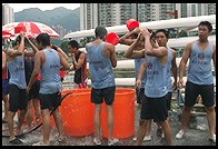 Hosing off after dragon boat racing.  Sha Tin, Hong Kong