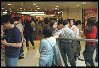 Waiting in Line for Dim Sum.  New Town Plaza shopping mall.  Sha Tin, Hong Kong