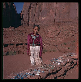 Navajo girl selling jewelry.  Monument Valley.