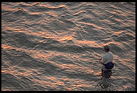 Fishing at sunset.  Looking towards Sanibel Island from Fort Meyers, Florida